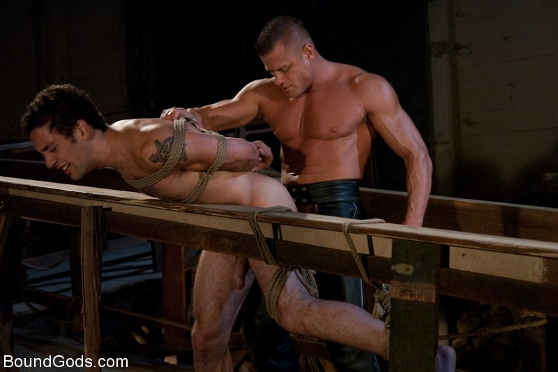 Muscular leatherman ties up and fucks a hot sailor