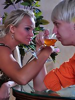 Hot babe shares a drink with a guy before giving a workout to his...